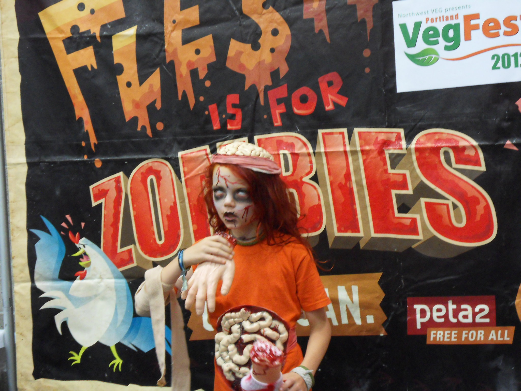 This girl gets my vote for VegFest zombie champion.