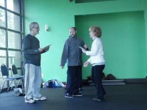 We passed our test! Here Catherine Egan, my coworker at West Coast Fitness, receives  her certificate.