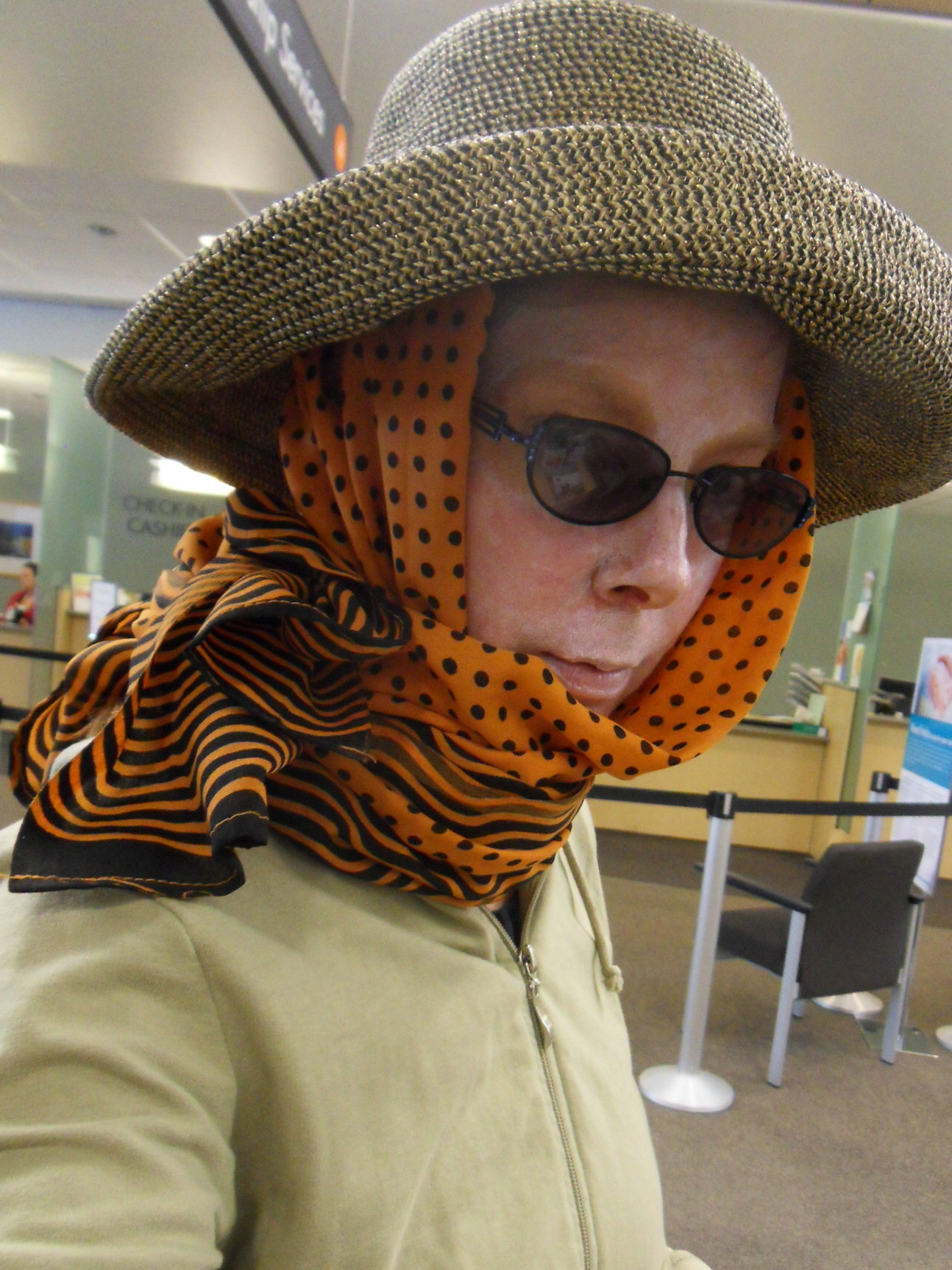 Here I get serious about the sun: hat, huge scarf and zinc oxide