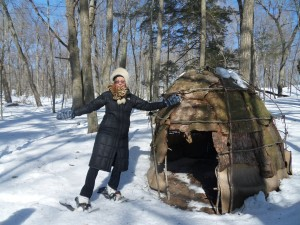 Here I show off my winter gear beside a recreation of a wigwam. Nomadic people lived in similar structures about 700 years ago.