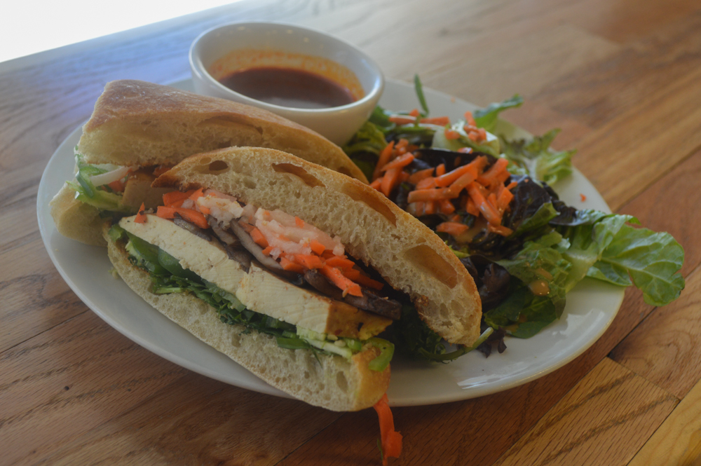 Vietnamese tofu sandwich with jalapenos and sweet and sour dipping sauce from Udi's Cafe. This popular lunch spot has lots of veg and gluten-free items. Udi's, of course, is a famous maker of gluten-free bread.