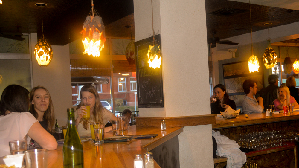 Sitting at the bar is a good way for a solo traveler to squeeze in on a busy Friday night at Watercourse.